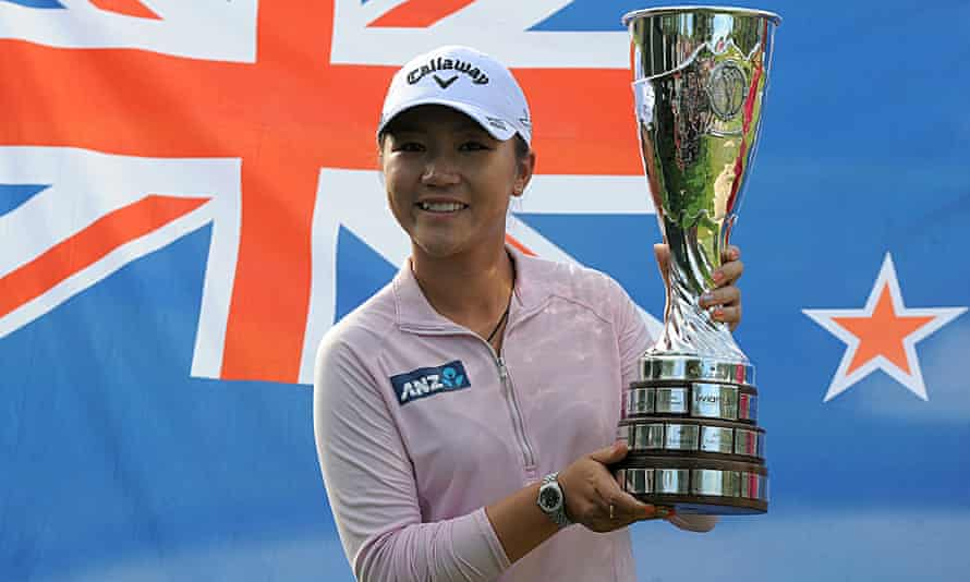 New Zealand's Lydia Ko poses with the Evian Championship trophy