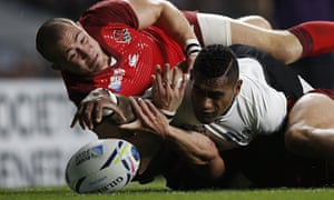 The try that wasn't: Fiji's scrum-half Nikola Matawalu is just foiled by England's Mike Brown.