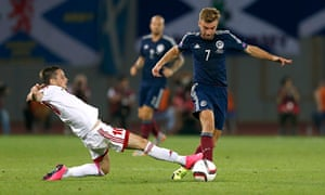 James Morrison is tackled by Zhano Ananidze of Georgia during Scotland's defeat in Tbilisi. Photograph: Peter Cziborra/Reuters