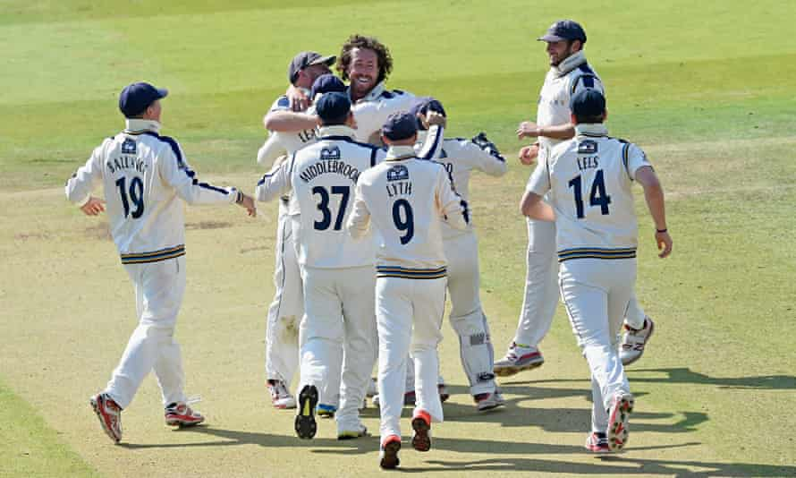 Ryan Sidebottom is mobbed by his Yorkshire team-mates