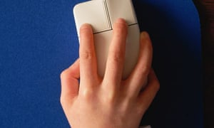 Boy's hand using computer mouse