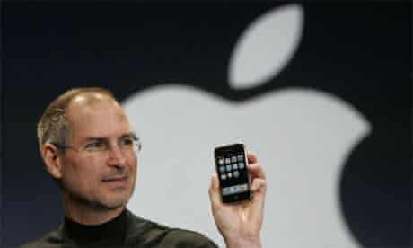 Apple CEO holds up an iPhone