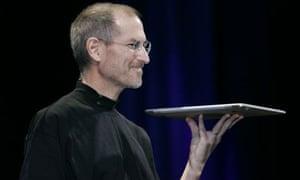 Apple CEO Steve Jobs shows off the MacBook Air