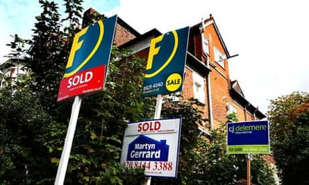 Sold signs outside house