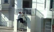 Man climbing fence