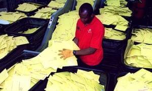 2001 Census: Royal Mail worker sorts envelopes