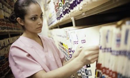 Nurse Looking Through Medical Records
