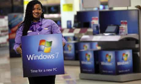 A computer shop employee prepares for the Windows 7 launch