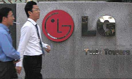 People walk past a LG Electronics logo at the company's headquarters in Seoul