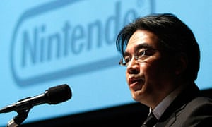 File photo of Nintendo Co President Iwata speaking in Tokyo