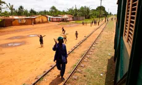 Locals wave at the train as it passes.