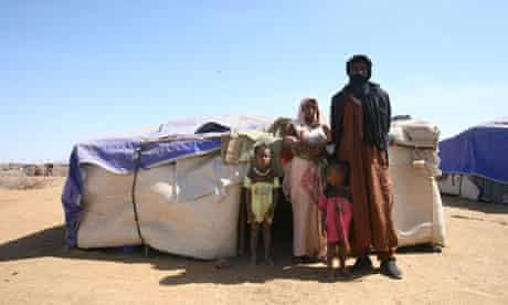Zicki Fli and family outside their tent
