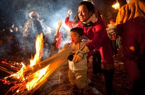 Father and toddler at Dosojin Fire Festival