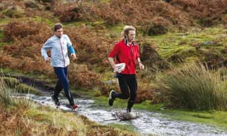 Adharanand Finn and his guide Ceri running across Dartmoor