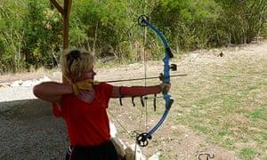 Rachel Dixon trying archery at Reservoir Range
