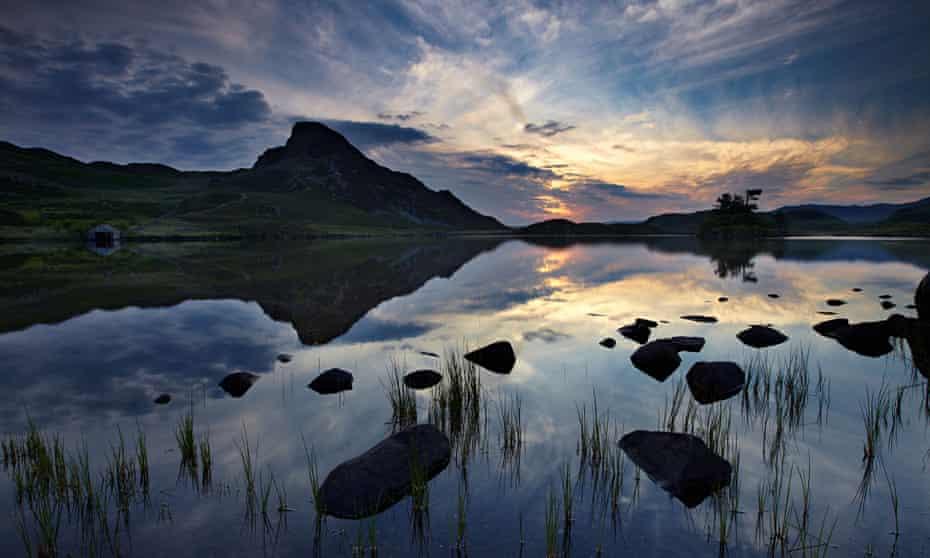 The lake beneath Cadair Idris in Snowdonia at dawn. Photograph: Alamy