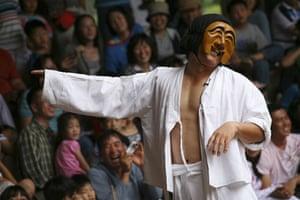Earthbound images: Mask theatre at Hahoe folk village, South Korea