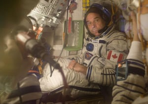 Soyuz spacecraft: Guy Laliberte sits in a space ship during tests at Baikonur cosmodrome