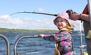 Amélie, Miranda's daughter, fishing off Kinsale
