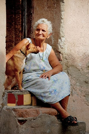 August Been there comp: Woman and dog, Cuba