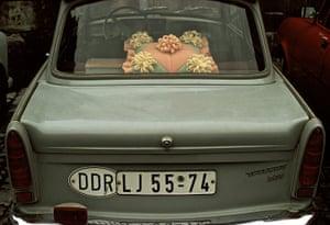 berlin vintage: Rear window of a 'Trabbi' (Trabant) car with decorative plastic cushion.