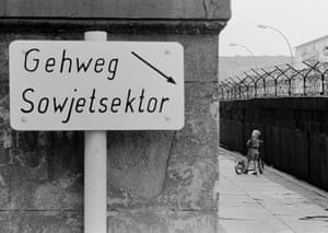 berlin vintage: Children playing at the Berlin Wall