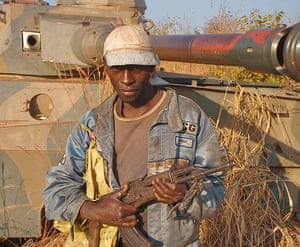 congo: Tank and armed local overlooking the village of Pweto