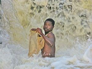 congo: Waterfall fisherman on the Luvua River