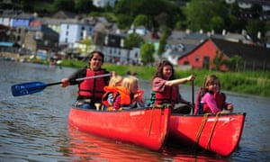 A family canoeing on the River Tamar, Devon and Cornwall border