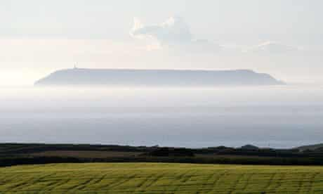 Lundy Island floating in the misty Bristol  Channel