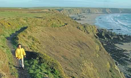 Woman walking the Pembrokeshire Coast Path
