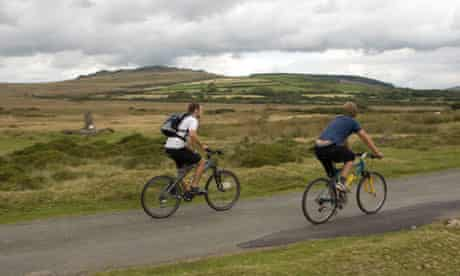 Cycling with Preseli hills in background.