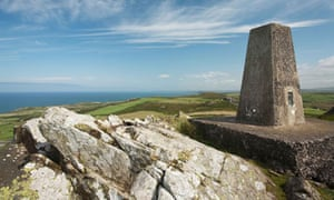 Trig point at Garn Fawr fort looking towards Strumble Head, Pembrokeshire