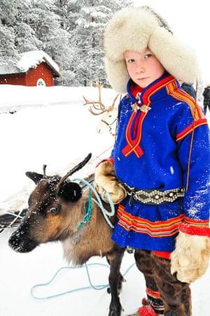 Sami Lapland: Sámi teenager and reindeer calf,  Jokkmokk