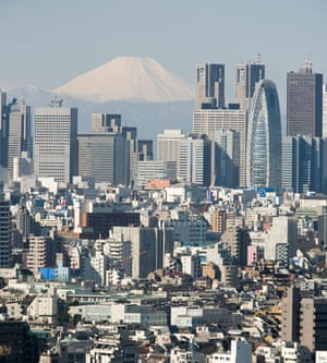 Skyline of Tokyo's Shinjuku district with Mount Fuji in the distance