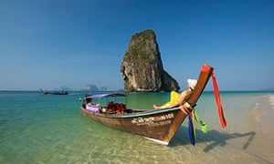 Relaxing on a long-tail boat in Thailand.