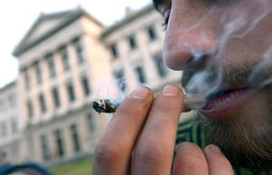 A man smokes marijuana outside Uruguay's Congress building, which has passed the world's most far-re