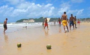 çoconuts for goalposts … playing football on Praia do Ponta Negra beach in Natal.