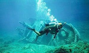 Scuba diver exploring a shipwreck in Gozo, Malta.