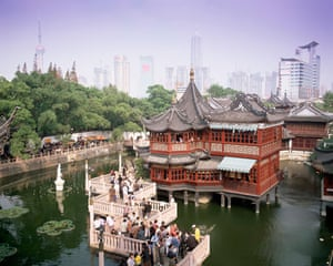 Tea house in Yuyuan Gardens and city skyline behind.