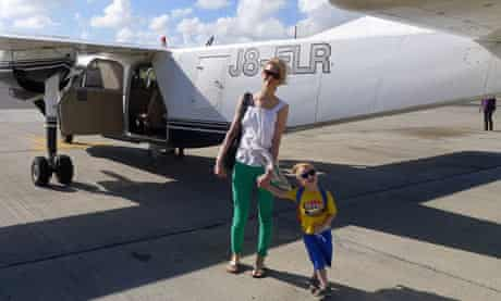 Isabel and son Ossian with the eight-seater plane that took them from Antigua to Barbuda