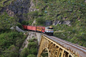 Ecuador train: Train approaches the Bridge over the Ambi river