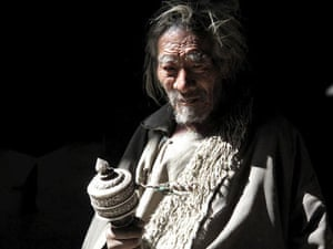 A Himalayan villager with a Tibetan prayer wheel.