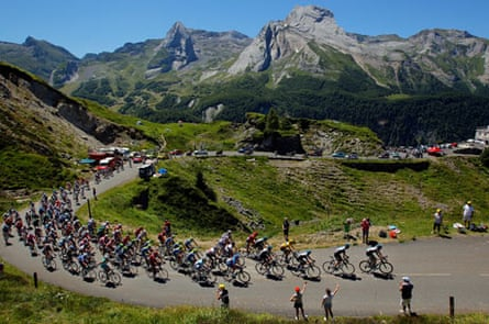 Team Sky leads the peloton on the climb of the Col d'Aubisque in the  2012 Tour de France; Bradley W