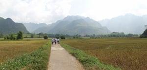 Walking through a village in the Mai Chau region