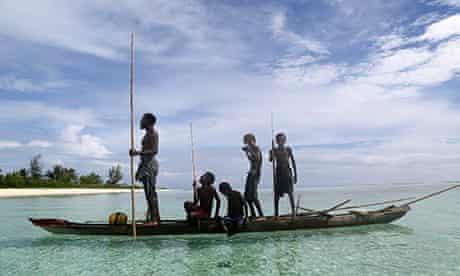 A family fishing on Tsoilik island, Papua New Guinea.