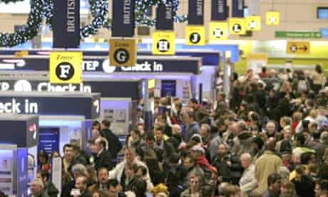 Passengers queue at a congested Heathrow airport