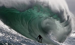 South African big wave surfer Andy Marr surfs a huge wave at the Dungeon off Cape Town, South Africa