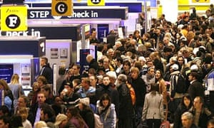Crowds at the check-in desks at Heathrow Airport Terminal 1