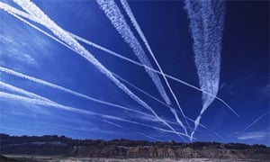 Green travel: plane contrails in the sky